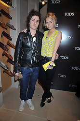 MAX MONTGOMERY and MARISSA MONTGOMERY at a party hosted by TOD's to celebrate the launch of the J.P.Loafer collection, held at the TOD's Boutique, 2-5 Old Bond Street, London on 31st March 2009.