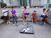 Singapore. Kids playing music on the street.