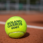 PARIS, FRANCE May 25. An official tournament tennis ball on the clay court surface at the 2021 French Open Tennis Tournament at Roland Garros on May 25th 2021 in Paris, France. (Photo by Tim Clayton/Corbis via Getty Images)