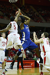 29 December 2010: Anthony Cousins strips the ball from Gregory Echenique during an NCAA basketball game where the Creighton Bluejays defeated the Illinois State Redbirds at Redbird Arena in Normal Illinois.