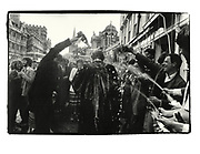 Champagne spraying after finals. High St. Oxford. 1981
