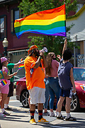 People participate in chants at the corner of 4th and Chestnut Streets during the Mifflinburg Pride Event.