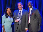 Diana Davila and Ken Huewitt present an award to Larry Seidl comments during the Scholars banquet, April 12, 2016.