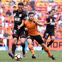 BRISBANE, AUSTRALIA - DECEMBER 11: Jesse Makarounas of Adelaide United compete for the ball Tommy Oar of the Roar during the round 10 Hyundai A-League match between the Brisbane Roar and Adelaide United at Suncorp Stadium on December 11, 2016 in Brisbane, Australia. (Photo by Patrick Kearney/Brisbane Roar)