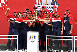 Team USA team celebrate with the Ryder Cup trophy after victory against Team Europe at the end of day three of the 43rd Ryder Cup at Whistling Straits, Wisconsin. Picture date: Sunday September 26, 2021.