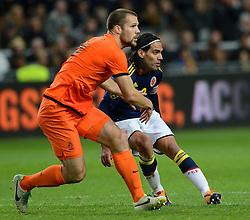 19-11-2013 VOETBAL: NEDERLAND - COLOMBIA: AMSTERDAM<br /> Nederland speelt met 0-0 gelijk tegen Colombia / Ron Vlaar, Radamo Falcao Garcia<br /> ©2013-FotoHoogendoorn.nl