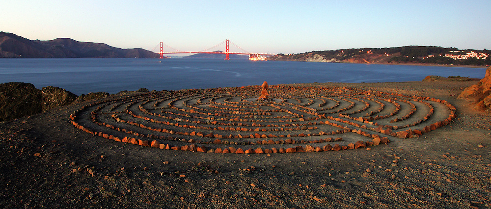Last light on the Lands End labyrinth with the lit Golden Gate Bridge in the background - San Francisco, California