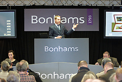 © Licensed to London News Pictures.  03/03/2012. OXFORD, UK. Auctioneer James Knight (pictured centre) conducts a classic car auction sale being held at Bonhams Oxford today. The car is estimated to sell for £10,000-12,000. Photo credit :  Cliff Hide/LNP