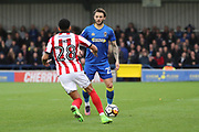 AFC Wimbledon defender Callum Kennedy (23) taking on Lincoln City midfielder Nathan Arnold (28) during the The FA Cup match between AFC Wimbledon and Lincoln City at the Cherry Red Records Stadium, Kingston, England on 4 November 2017. Photo by Matthew Redman.