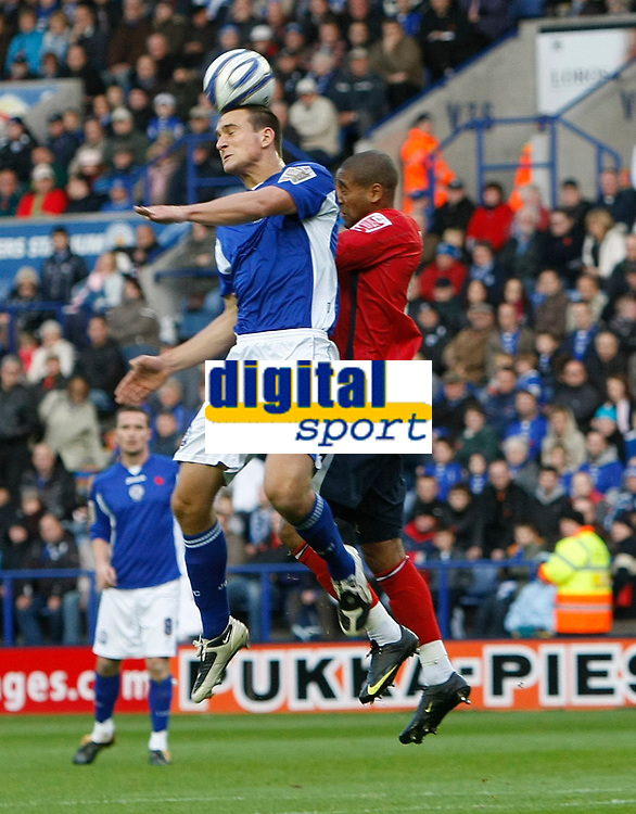 Photo: Steve Bond/Richard Lane Photography. Leicester City v West Bromwich Albion. Coca Cola Championship. 07/11/2009. Luke Moore (r) is outjumped by Bruno Berner
