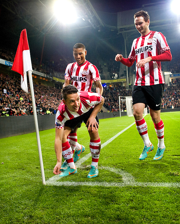"""The Netherlands, Eindhoven, 11-11-2012.<br /> Football, National, Eredivisie.<br /> PSV - Heerenveen : 5-1.<br /> Dries Mertens scored 0-1 for PSV with a perfect shot and is celebrating that with """"a-hole-in-one"""" together with Luciano Narsingh en Tim Matavz ( right ).<br /> Photo : Klaas Jan van der Weij"""