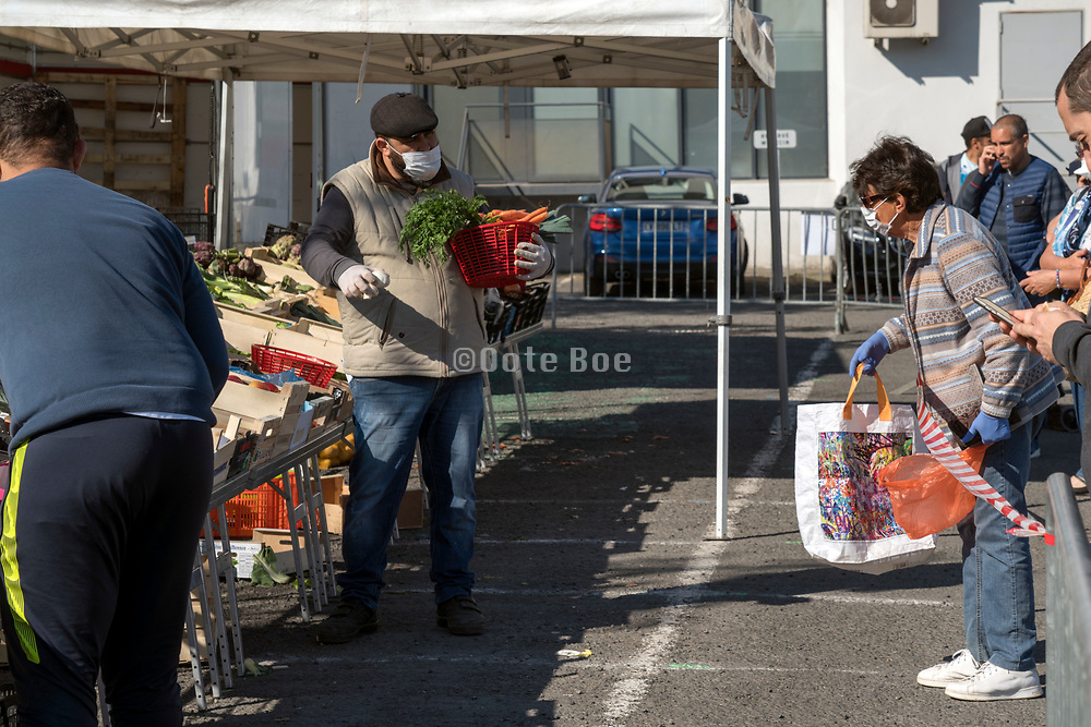 outdoors food market with social distance protection during the Covid 19 crisis France Limoux April 2020