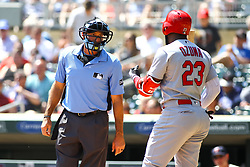 May 16, 2018 - Minneapolis, MN, U.S. - MINNEAPOLIS, MN - MAY 16: St. Louis Cardinals left fielder Marcell Ozuna (23), right, argues with umpire Angel Hernandez (5) after a strike 3 call in the top of the 1st inning during the regular season game between the St. Louis Cardinals and the Minnesota Twins on May 16, 2018 at Target Field in Minneapolis, Minnesota. (Photo by David Berding/Icon Sportswire) (Credit Image: © David Berding/Icon SMI via ZUMA Press)