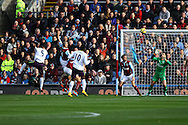 (l) Everton's Samuel Eto'o heads and scores his teams 1st goal Barclays Premier league match, Burnley v Everton at Turf Moor in Burnley, Lancs on Sunday 26th October 2014.<br /> pic by Chris Stading, Andrew Orchard sports photography.