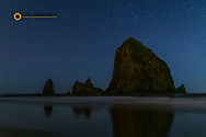 Starry skies above Haystack Rock in Cannon Beach, Oregon, USA