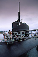 Officer on gangplank walkway and navy enlisted man salute, Naval sumbarine Base, Point Loma, San Diego, Cailfornia