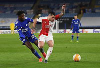 Football - 2020 / 2021 Europa League - Round of 32 - Second Leg - Leicester City vs Slavia Prague - King Power Stadium<br /> <br /> Slavia Prague's Nicolae Stanciu holds off the challenge from Leicester City's Wilfred Ndidi.<br /> <br /> COLORSPORT/ASHLEY WESTERN