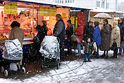 Because Susanne is at her nursing job, Jörg lines up in the snow outside to buy meat at the Saturday market in neighboring Ahrensburg. Hungry Planet: What the World Eats (p. 136).