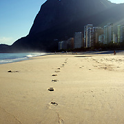 Foot prints in the sand, a beach scene at Sao Conrado beach, Rio de Janeiro,  Brazil. 7th July 2010. Photo Tim Clayton..