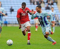 Bristol City's Mark Little battles for the ball with Coventry City's Jordan Clarke  - Photo mandatory by-line: Joe Meredith/JMP - Mobile: 07966 386802 - 18/10/2014 - SPORT - Football - Coventry - Ricoh Arena - Bristol City v Coventry City - Sky Bet League One