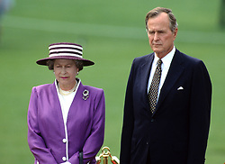Queen Elizabeth ll with US President George Bush Snr. on the White House lawn in Washington DC on May 14, 1991.