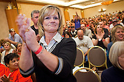 Nov. 11, 2009 -- PHOENIX, AZ: LISA REECE, an employee of a Frys' store in Glendale, AZ, cheers during a meeting of members of the UFCW at the Airport Marriott Hotel in Phoenix. The United Food and Commercial Workers Union (UFCW) Local 99 has about 25,000 members in Arizona: 15,000 in Fry's grocery stores and Fry's Marketplace, 9,500 in Safeway stores and 400 in Smith's grocery stores. The union voted down the last proposal from the stores and has announced plans to go on strike at 6PM on Friday, Nov. 13. The meeting Wednesday is the last one before the strike.   Photo by Jack Kurtz