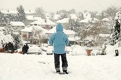© under license to London News Pictures.2.12.2010 A woman looks at the Snow in Orpington today (Thurs). Picture credit should read Grant Falvey/London News Pictures
