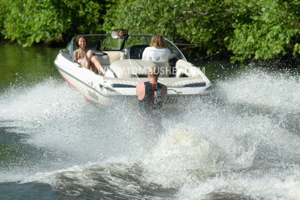 Monroe, NY -A man wake boards as a woman on the boat looks on at Twin Lakes Water Ski area on June 1, 2008.