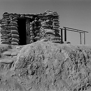 Aug 10, 2009 - Kandahar Province, Afghanistan - A sandbagged building on top of a defensive wall at a NATO and Afghan forward operating base on the front lines in the insurgent stronghold of Panjway District outside Kandahar City, Afghanistan.<br /> (Credit Image: © Louie Palu/ZUMA Press)