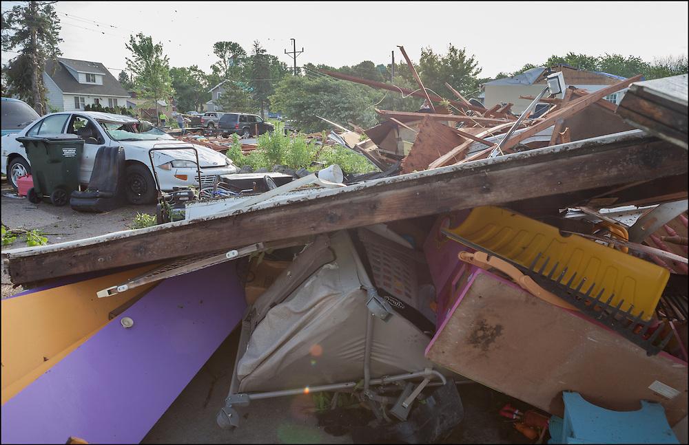 An EF-2 tornado damaged multiple houses creating debris to scatter around neighborhoods in Watkins, Minnesota.