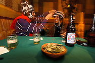 """At """"Goto de Agua"""", typical """"peña"""" of La Paz, every order is accompanied by a dish of coca leaves"""
