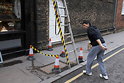 Health and safety in use around a ladder where workmen are climbing up onto a building. London, UK. Health and safety law is a body of law that protects the health, safety and welfare of the general public and certain defined sectors of the population such as employees.