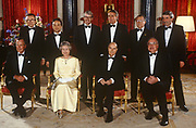 Heads of state of the G7 economic nations, including in the front row: President George Bush Snr, Queen Elizabeth II, Francois Mitterrand, Helmut Kohl and at the back, centre, John Major - gather for an official portrait on 17th July 1991 at Buckingham Palace, London England.