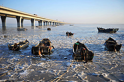 February 6, 2018 - Qingdao, China - Fishing boats can be seen at the partially frozen Jiaozhou Bay in Qingdao, east China's Shandong Province. (Credit Image: © SIPA Asia via ZUMA Wire)