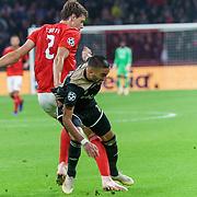 NLD/Amsterdam/20181023 - Champions Leaguewedstrijd  Ajax - SL Benfica, nr. 2 German Conti en  nr. 22 Hakim Ziyech