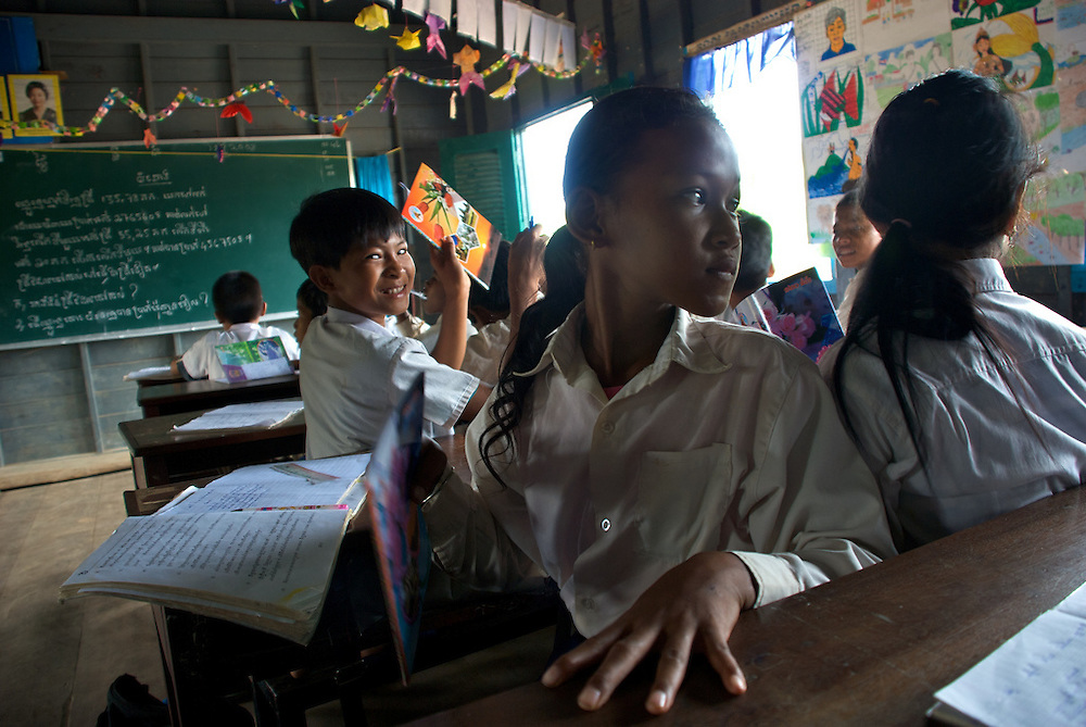 Fourth grade students compare answers during their class in the floating village of Chong Kneas just outside of Siem Reap, Cambodia.