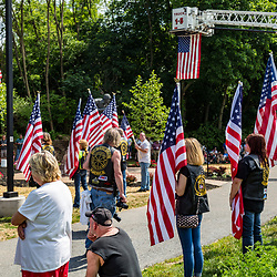 Ephrata, PA, USA - May 25, 2015: Community members hold American flags during the dedication ceremony of Band of Brothers commander Major Richard Winters Memorial.