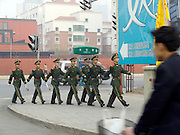 paramilitary police marching in the streets of Beijing China