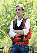 The guardian of Teth's stone lock-in tower in national dress. Teth, Tethi, Albania. 03Sep15