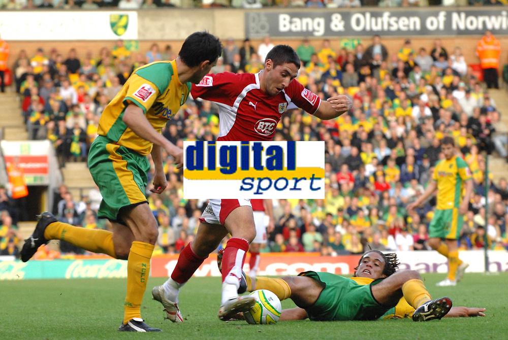 Photo: Ashley Pickering.<br /> Norwich City v Bristol City. Coca Cola Championship. 20/10/2007.<br /> Bradley Orr of Bristol (C) is tackled by Darel Russell of Norwich (R)