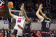 DALLAS, TX - JANUARY 04:  Ben Moore #00 of the SMU Mustangs drives to the basket against Ernest Aflakpui #24 and Obi Enechionyia #0 of the Temple Owls during a basketball game on January 4, 2017 at Moody Coliseum in Dallas, Texas.  (Photo by Cooper Neill/Getty Images) *** Local Caption *** Ben Moore; Ernest Aflakpui; Obi Enechionyia
