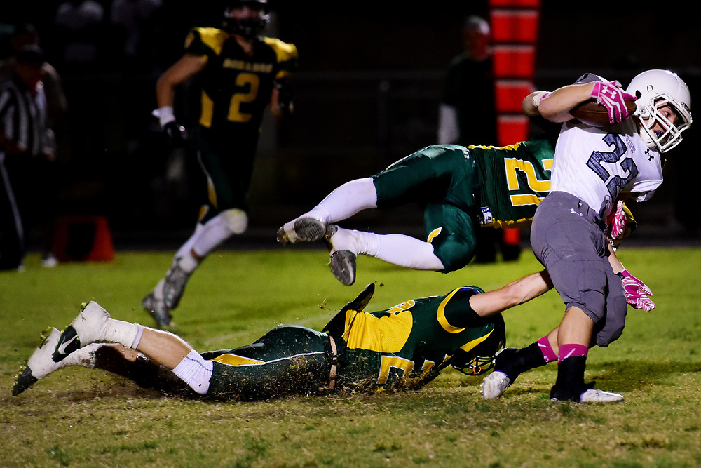 Mountain View's Wyatt Adams (22) is tackled by Canyon del Oro defense during Canyon del Oro's 43-40 win over Mountain View at Canyon del Oro High School in Tucson, Arizona on Friday, Oct. 23, 2015. (Rebecca Noble/for Arizona Daily Star)