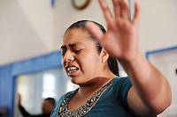 A parishioner at Fuente de Vida Church loses herself in prayer during Easter Sunday services in Salinas.