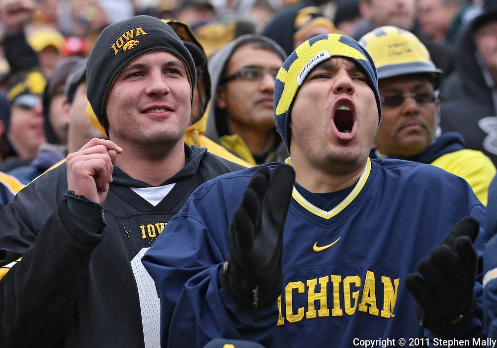 November 05, 2011: Fans cheer during the second half of the NCAA football game between the Michigan Wolverines and the Iowa Hawkeyes at Kinnick Stadium in Iowa City, Iowa on Saturday, November 5, 2011. Iowa defeated Michigan 24-16.