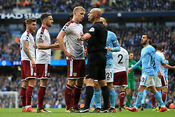 21st October 2017 - Premier League - Manchester City v Burnley - Ben Mee of Burnley speaks to referee Roger East - Photo: Simon Stacpoole / Offside.