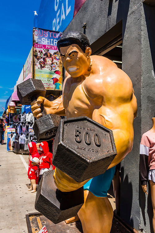 Shops selling souvenirs at Muscle Beach, Venice, Los Angeles, California USA.