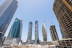 Construction sites with many skyscrapers being built in new Business Bay district in Dubai United Arab Emirates