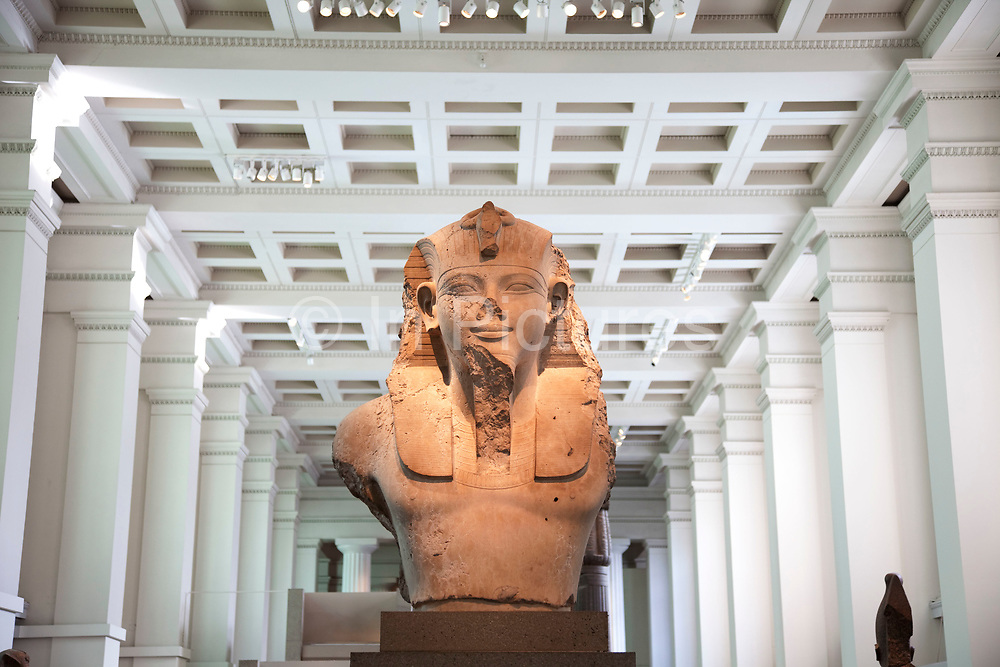 The British Museum, London. The ancient Egyptian sculpture room. Artifacts from Egypt on display including Pharaoes sculptures.
