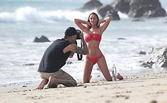Playboy Playmate Charlie Riina poses in sexy red bikini at the beach in Malibu - 25 Dec 2018