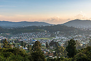 Late afternoon view from the hillside of a tea plantation of the city of Nuwara Eliya, Sri Lanka